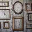Empty frames and watch on wooden wall — Stock Photo