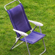 Canvas chair on grass — Stock Photo