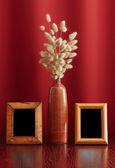 Vintage photo-frames and ikebana — Stock Photo