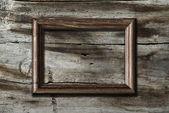 Frame on wooden background — Stok fotoğraf