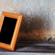 Vintage photo-frame on table - Stock Photo