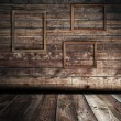 Wooden interior with frames — Stock Photo