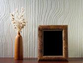 Ikebana and vintage photo-frame — Stock Photo