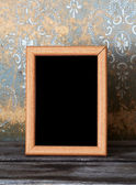 Photo-frame on old table — Stock Photo