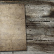 Vintage paper on wood texture — Stock Photo