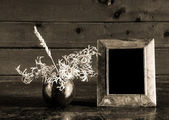 Photo-frame and ikebana — Stock Photo