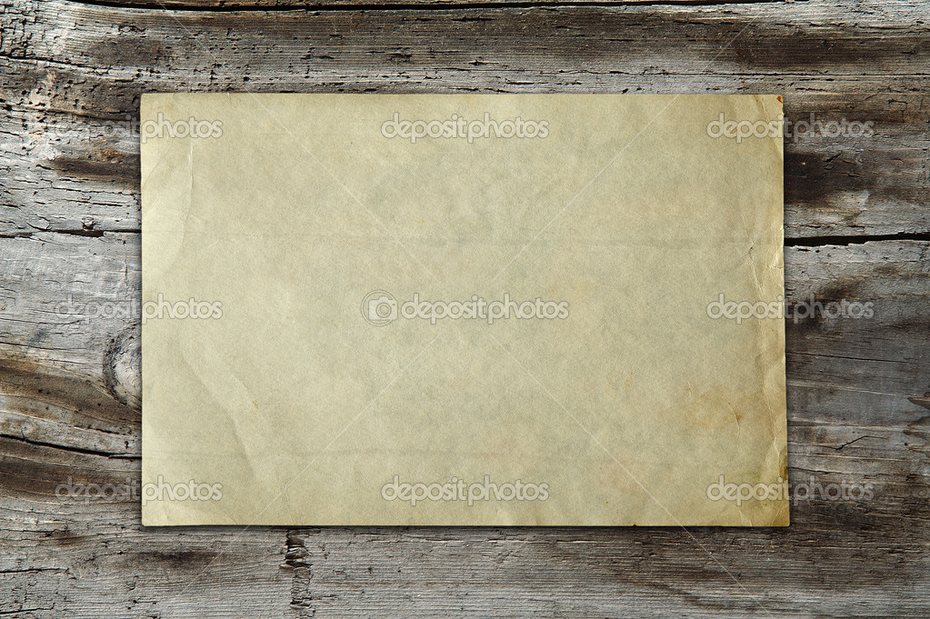Vintage paper on old wood texture  Stock Photo #1926886