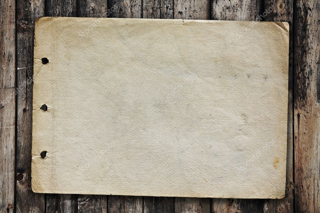 Vintage paper on old wood texture — Stock Photo #2044325