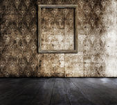 Grunge room with frame — Stockfoto