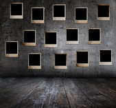 Grunge interior with photos — Stock Photo