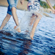 Stock Photo: Couple splashing at the beach
