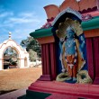 Shiva statue and Hindu temple - Stock Photo