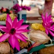 Offerings: pink lotus, yellow flowers - Stock Photo