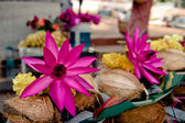 Offerings: pink lotus, yellow flowers — Stock Photo