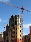 Crane near the new high house — Stock Photo