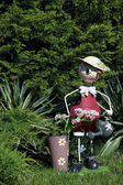 Little man in garden — Stock Photo