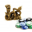 Metal dragon and a pile of colore — Stock Photo #2241243