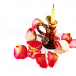 Burnt candle and dry rose with petals - Stock Photo