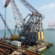 Stock Photo: Floating crane on site