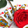 Stock Photo: Rose over playing card