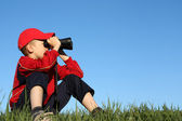 Boy looks into binoculars — Stock Photo