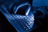 Hands of hacker — Stock Photo