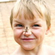 Royalty-Free Stock Photo: The boy with the lizard on a nose