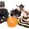 Three children with pumpkin — Stok fotoğraf