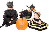 Three children with pumpkin — Stock Photo