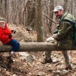 A halt in the woods. Father and son rest — Stock Photo