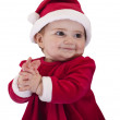 Stock Photo: The little girl in a red dress New Year