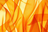 Orange organza background — Stock Photo
