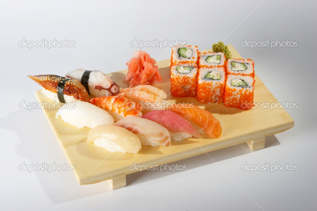 Sushi and rolls on the tray — Stock Photo #1185521