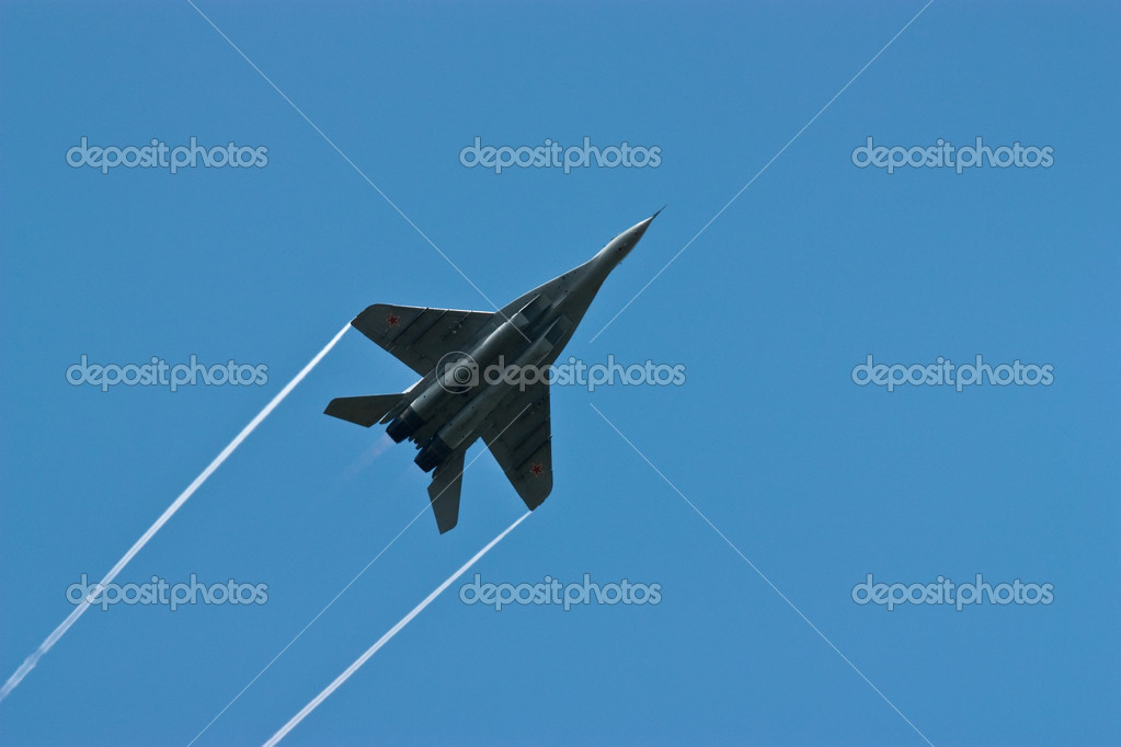 Jet fighter in flight against the dark blue sky  Stock Photo #1240351