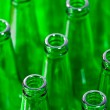 Rows of green beer bottles — Stock Photo