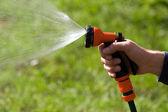 Water sprinkler in the sun — Stock Photo
