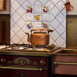 Copper Kettle on stove — Stock Photo