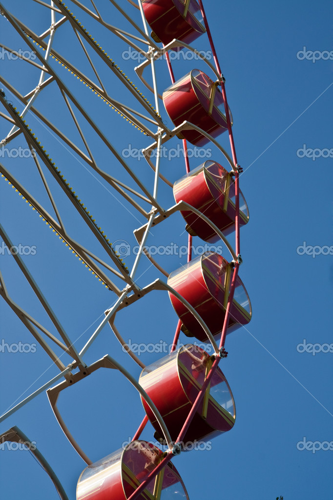 White ferris wheel against a deep blue sky — Stock Photo #1384163