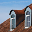 Red roof and windows — Stock Photo
