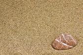 Sand and sea stone — Stock Photo