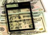 La calculatrice et dollars 2 — Photo