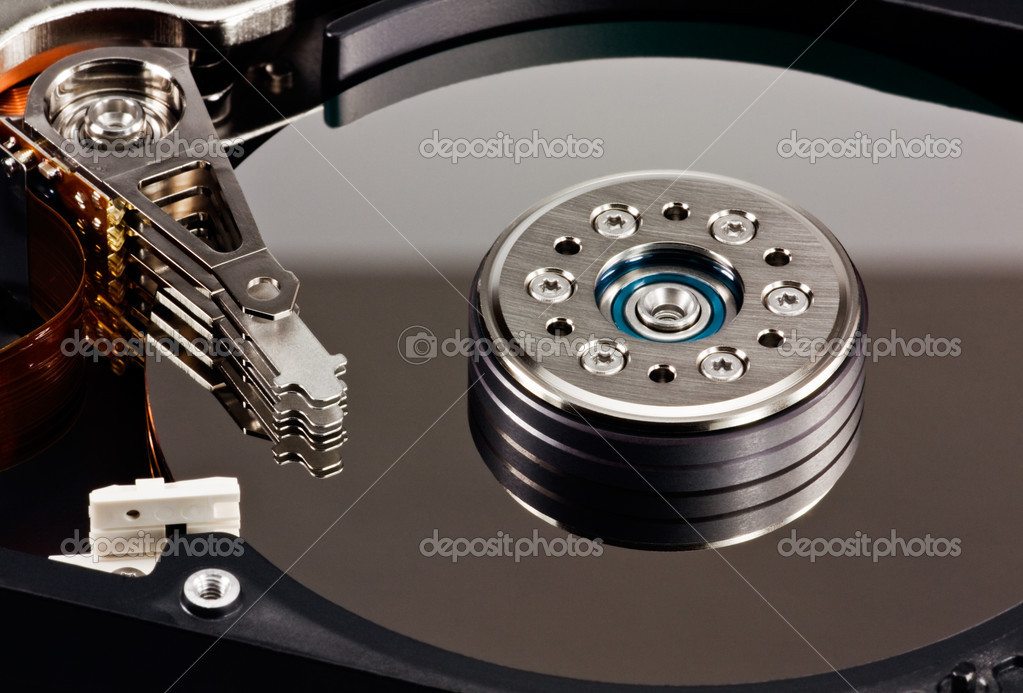 A close up of an opened computer hard disk drive — Stock Photo #1489754