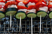 Kebabs on the grill — Stock Photo