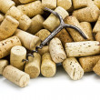 Old corkscrew and wine corks — Stock Photo #2467507