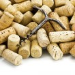 Old corkscrew and wine corks — Stock Photo
