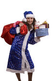 Santa woman is holding red sack with gif — ストック写真