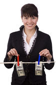 Business woman is hanging hundred dollar — Stock Photo
