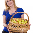 Girl with a basket full of fruits — Stock Photo