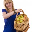 Photo: Girl with a basket of apples.