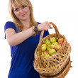 Stock Photo: Girl with a basket of apples.